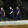 Manhunt on foot: Wabash Valley correctional officers comb a wooded area near the Carlisle prison Tuesday afternoon.