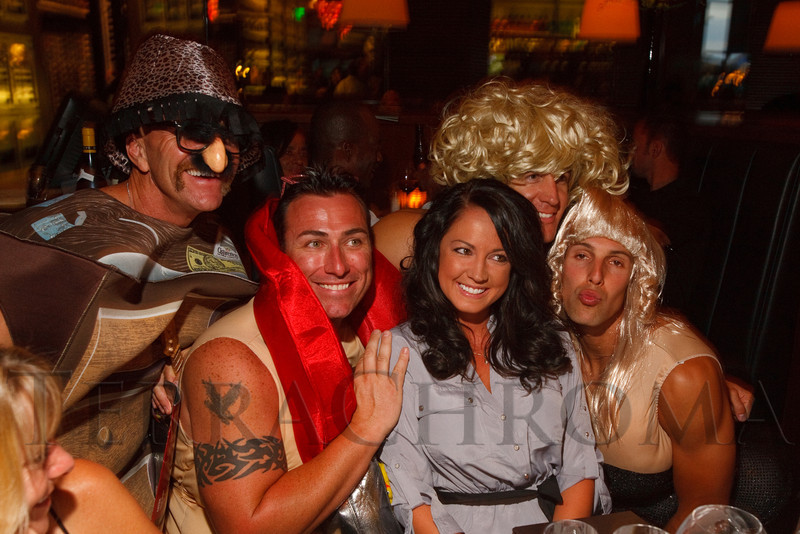 (Denver, Colorado, Aug. 27, 2011)<br /> Kip Korthuis, Corey Piper, Brian Thorngate, and Neal Martin, all members of the 2012 Colorado Firefighter Calendar, pose for a photo with Chelsea Dortch (Southern Wine and Spirits).  Celebrity Waiter event, a Concerts for Kids benefit, at Shanahan's Steak House in Denver, Colorado, on Saturday, Aug. 27, 2011.<br /> STEVE PETERSON