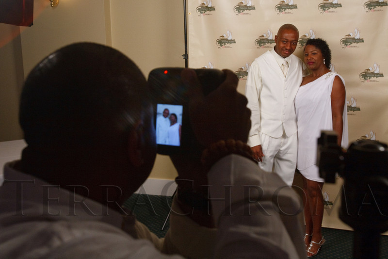 (Denver, Colorado, Aug. 27, 2011)<br /> Joe and Kimberly Kincaid have their picture taken by Juan Clipper.  Summer White Party, hosted by the Urban League of Metropolitan Denver, at Green Gables Country Club in Denver, Colorado, on Saturday, Aug. 27, 2011.<br /> STEVE PETERSON