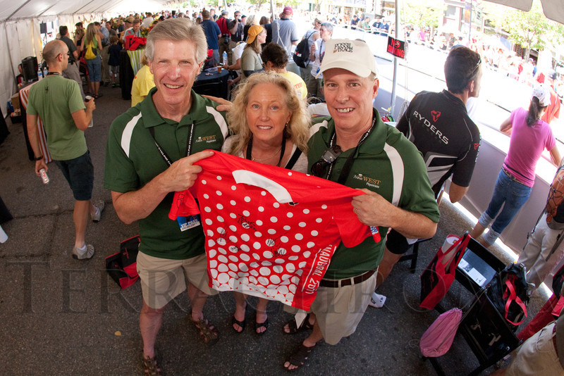 (Golden, Colorado, Aug. 28, 2011)<br /> Ken and Andrea Cohen with Mark Pattridge holding a KOM jersey with a few autographs.  Ken and Mark are with New West Physicians, the yellow jersey sponsor for the stage.  The USA Pro Cycling Challenge, Stage 6, from Denver to Golden, Colorado, on Sunday, Aug. 28, 2011.<br /> STEVE PETERSON