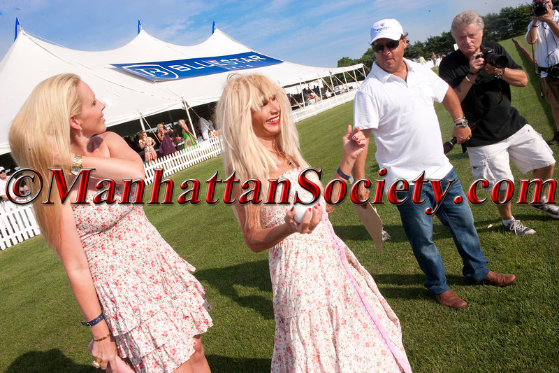 Betsey Johnson gets ready to throw in the ball starting the game at BRIDGEHAMPTON POLO 15th Anniversary Season Kick Off on Saturday, July 23, 2011 at The CIRCA Championship Field, Two Trees Farm, 849 Hayground Road, Bridgehampton, NY PHOTO CREDIT: ©Manhattan Society.com 2011