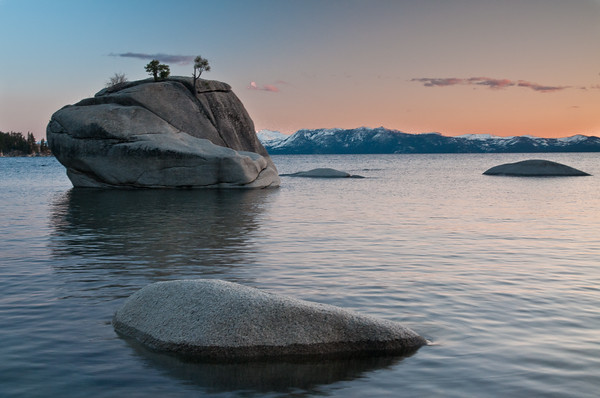 "This is one of the more ""standard"" (more common) Bonsai Rock photos -- with the trees and mountains in the background. Unfortunately, the sun was setting more northerly and there wasn't really any color in the sky in this direction. Again, I abandoned this composition but posted it in case people stumble upon this and want some help."
