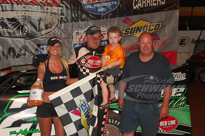 Jimmy Owens and son Nathan in Victory Lane with Cleveland Speedway promoter -- Monty Morrow