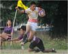 陸軍官校選手躍起閃避逢甲大學選手的防守. 陸官在第一場比賽負於海大後,在本場比賽找到進攻節奏,以38:0大勝逢甲大學.(2011/5/14)