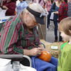 Free pumpkin painting was available at the Beacon Sloop Club hosted Annual Pumpkin Festival at the waterfront in Beacon, NY on Sunday, October 16, 2011. Hudson Valley Press/CHUCK STEWART, JR.
