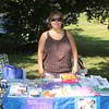 Orange County Department of Health Coordinator Mandy McGarrah hands out free information at the annual Family Day in the Park event held at Downing Park in the City of Newburgh on Saturday, July 9, 2011. Hudson Valley Press/CHUCK STEWART, JR.