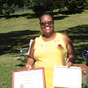Denise Robinson, owner of Denise's Travel Agency, hands out free travel information at the annual Family Day in the Park event held at Downing Park in the City of Newburgh on Saturday, July 9, 2011. Hudson Valley Press/CHUCK STEWART, JR.