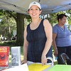 Fidelis Care Marketing Representative Riki Peterson-Jicha hands out free information at the annual Family Day in the Park held at Downing Park in the City of Newburgh on Saturday, July 9, 2011. Hudson Valley Press/CHUCK STEWART, JR.