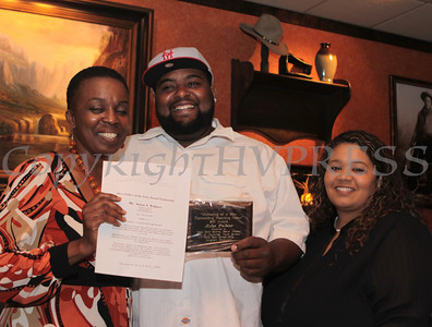 Irene Scott-Bethea presents Aston Palmer with a 2011 Father of the Year Award, along with Maritza Wilson, at Longhorn Restaurant on Friday, June 17, 2011. Hudson Valley Press/CHUCK STEWART, JR.