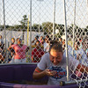 Kristina Hanlon of AIDS Related Community Services, takes her place in the dunk booth during the City of Newburgh's 14th National Night Out Against Crime on Tuesday, August 2, 2011 in Delano-Hitch Park. Hudson Valley Press/CHUCK STEWART, JR.