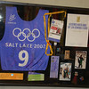 A shadow box Kris had made for Dave of his Olympic Memorabilia.  <br /> <br /> During the 2002 Salt Lake Winter Olympics Dave was a member of the hill crew.