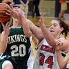 Tribune-Star/Jim Avelis<br /> No doubt: Terre Haute North center Adrienne Pritchard makes sure West Vigo's guard Brooklyn Waters can't get a shot off in second quarter action Thursday night in the Patriot's gym.