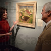 Tribune-Star/Jim Avelis<br /> On display: Marianne Richter, executive director of the Swope Art Museum, talks with board member Rick Shagley about one of Grant Wood's works. The work is one of the original artworks of the museum.