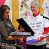 Tribune-Star/Jim Avelis<br /> Memories: Mary Beth Harris is presented with a book of letters from her staff and students at an assembly at Fuqua Elementary School.