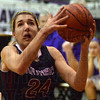 Tribune-Star/Jim Avelis<br /> Inside job: Riverton-Parke guard Sara Dickey eyes and easy two in the Panther's game at Clay City Thursday night.