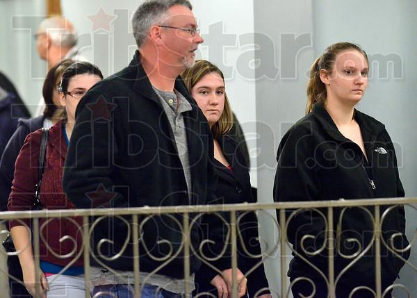 Tribune-Star/Joseph C. Garza<br /> Awaiting sentence: Lindsay Pinegar, center, walks to Vigo Superior Court 1 with family and friends for her sentencing Thursday in the Vigo County Courthouse.