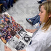 Tribune-Star/Joseph C. Garza<br /> Remembering Nathaniel: Tondra Matheny, a friend of the Lawson family, looks over a poster of photos of the late Nathaniel Lawson outside of Vigo Superior Court 1 Thursday at the Vigo County Courthouse.