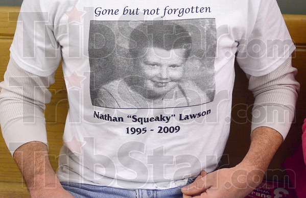 Tribune-Star/Joseph C. Garza<br /> Gone but not forgotten: John Matheny wears a shirt with the photo of the late Nathan Lawson outside of Vigo Superior Court 1 Thursday in the Vigo County Courthouse.