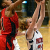 Tribune-Star/Jim Avelis<br /> Too tall: Layne Curley has her shot blocked by North Central's Celeste Edwards in first quarter action.