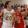 Tribune-Star/Jim Avelis<br /> State of denial: Jacob Duncan(22) and Rhett Smith(20) jockey for position in the paint the first semi-final game on the Pizza Hut Wabash Valley Classic Thursday night.