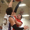 Tribune-Star/Jim Avelis<br /> Too tall: Thomas Sisson has his shot blocked by Sullivan's Rhett Smith.