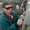 Tribune-Star/Joseph C. Garza<br /> Making the connection: Electrician Frank Mershon of the I.B.E.W.'s retiree club, builds the connection for electrical service at a house on north 12th Street Thursday.