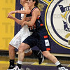 Tribune-Star/Jim Avelis<br /> Body language: Sullivan standout Rhagen Smith battles with Terre Haute North's Nicole Anderson for control of the paint.