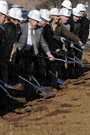 Tribune-Star/Joseph C. Garza<br /> Moving earth: UAP CEO Pat Board, third from left, tosses a load of dirt to symbolically start the construction of the new UAP Clinic Medical Office building Thursday.