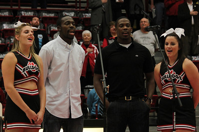 Molly McKinney, Marquis Sanders, Keron Phelps and Lauren Davis sing the National Anthem before the game againt Alice Lloyd