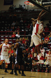 Number 11, Jason Dawson tries for the layup