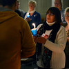 "Tribune-Star/Joseph C. Garza<br /> Sharing a light of hope: Robin Andrews, center, helps light the candle of another participant in the Compassionate Friends' 15th Annual ""Worldwide Candle Lighting"" Sunday at the Unitarian Universalist Church."