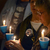 "Tribune-Star/Joseph C. Garza<br /> For Cam: Pam Bird holds a candle for her late son, Cameron Langenfeld, during the Compassionate Friends' 15th Annual ""Worldwide Candle Lighting"" Sunday at the Unitarian Universalist Church."