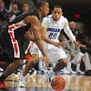 Tribune-Star/Jim Avelis<br /> Defense: Dwayne Lathan sticks with Maryville's Asa Toney in first half action Saturday.