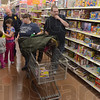 "Tribune-Star/Jim Avelis<br /> Decisions, decisions: The Stanton family, April and Andrew, along with their children Tyana and Paula take part in the ""Kids shopping with Police"" early Sunday morning at the eastside Walmart. With them is Terre Haute police Sgt. Bill Sheldon."