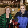Tribune-Star/Jim Avelis<br /> Planners: Janice Board, volunteer coordinator, and Tiffani Schmidt, Executive Director for the Terre Haute Symphony, pose with the trophy that will go to the winner of the tree decorating contest.