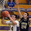 Tribune-Star/Jim Avelis<br /> Pressure: Sullivan's Lance Ellett tries a layup under presure from Union guard Tyler Talpas.