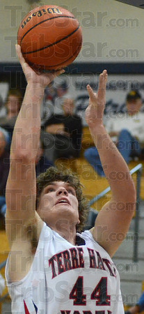 Tribune-Star/Jim Avelis<br /> Easy two: Calvin Blank gets an easy two in second quarter action with Mooresville Friday night in the Terre Haute North gym.