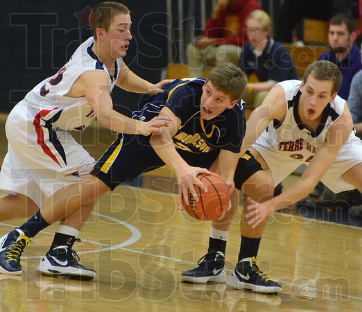 Tribune-Star/Jim Avelis<br /> Ganging up: Terre Haute North's Nathan Jahn and Matt O'Leary surround Mooresville guard Josh Kenney in first half action on the Patriot's floor.