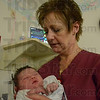 Tribune-Star/Jim Avelis<br /> Cared for: Union Hospital neonatal care nurse Sue Tichy holds little Sarah Kraemer in the NICU Friday afternoon.