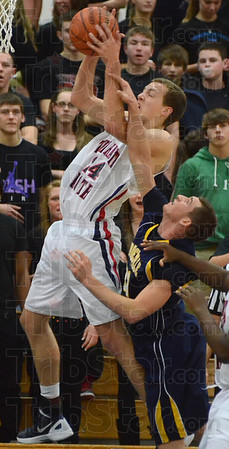 Tribune-Star/Jim Avelis<br /> Way up: Terre Haute North's Matt O'Leary leaps for a rebound in front of a Mooresvile defender.
