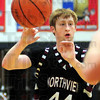 Dump: Northview's #44, Jacob Ninesling dumps the ball to a teammate in the lane during game action Friday night.