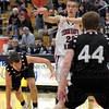 Dish: North's #22, Steven Davis dishes the ball as he drives the lane during action Friday night.