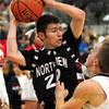 Protection: Northview's #20 Dillion Reynolds protects the ball against a North defender Friday evening.
