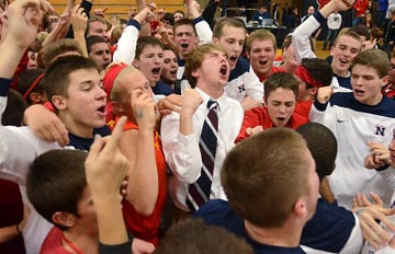 Tribune-Star/Joseph C. Garza<br /> Members of the Terre Haute North boys basketball team sing along with their fellow students to the North fight song after the Patriots defeated Sullivan to win the Pizza Hut Wabash Valley Classic championship game Friday at North.