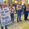 Tribune-Star/Jim Avelis<br /> Sign language: Pam Craft, a fifth grade teacher from the Culver School corporation listens to activities in the Indiana Senate Tuesday afternoon. She and hundreds of others descended on the statehouse to make their feelings known on legislation regarding Right to Work and other topics affecting union members.