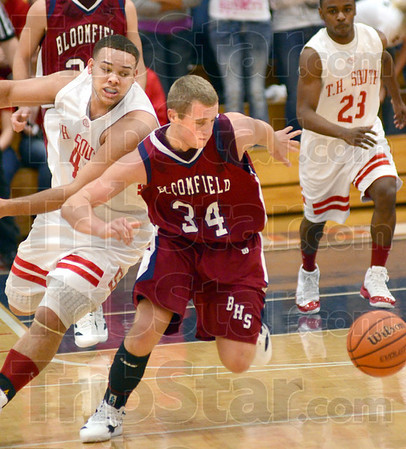 Ball scramble: Bloomfield's #34, Kyle Doane chases the ball after South's #40, Jerrery Turner poked it away while defending.