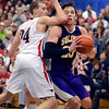 Tribune-Star/Joseph C. Garza<br /> Physical game? You betcha!: Terre Haute North's Matt O'Leary tries to stop a driving Rhett Smith of Sullivan during the Patriots' win in the final of the Pizza Hut Wabash Valley Classic Friday at North.