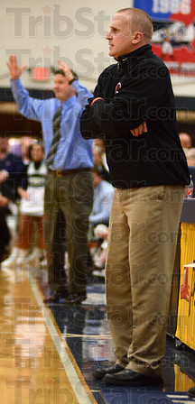 Tribune-Star/Jim Avelis<br /> Contrasts: Marshall coach Tom Brannan surveys the action on the floor while in the background his West Vigo counterpart, Joe Boehler, questions a call.