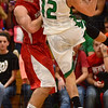 Tribune-Star/Jim Avelis<br /> Stifled: Jacob Duncan gets a hand on the ball as West Vigo standout Jordan Houser tries to score.