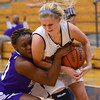 Tribune-Star/Joseph C. Garza<br /> Physical play: Terre Haute North's Morgan Stewart tries to maintain control of the ball as she is fouled by Ben Davis' Chyna Sanders Saturday during the Patriots' win at North.
